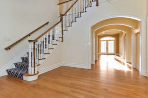 Grand two-story Foyer with eye catching archways