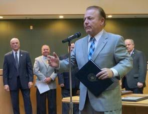 State Senator Joseph Pennacchio reads Congressman Rodney Frelinghuysen's letter to the township
