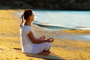 Carousel image 64152a86c734adbbe5f3 bigstock  woman yoga onthebeach 50428325