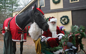 Carousel_image_6ce62892d2c0afb87196_santa_and_his_helping_horse