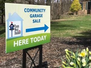 Carousel_image_73763825e06ff14e2416_community_garage_sale_lawn_sign_in_front_lawn__1_