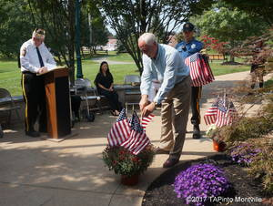 Carousel_image_8483326bb18e89a26e5a_a_as_former_commander_frank_warholic_reads_the_names_and_groups__committee_member_rich_conklin_and_ptl_samuel_greendyk_place_flags_around_the_twp_s_9-11_memorial