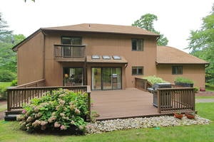 Oversized deck and large beautiful yard backs to private wooded area!