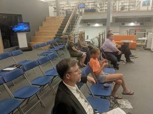 Carousel image c7f9eda443ed48aed3d8 1   july 16a president of the boe scott silverstein sits in the audience with the other residents