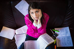 Carousel_image_cb11010aa57f6132e3a6_bigstock-tired-student-having-a-lot-to--78889934