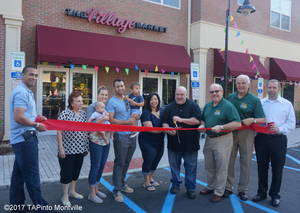 Carousel image d107ed09a8ebbf01620c a ribbon cutting at village market in towaco 1