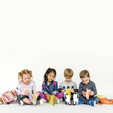 Carousel_image_d886298399d146b946d2_childrenreading_from_admin