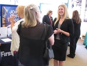 Carousel_image_dcb1da08f7bcb08cfea6_kyersten_geiger_speaks_to_a_career_fair_attendee