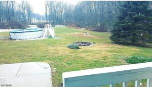 Large backyard with pool and firepit!