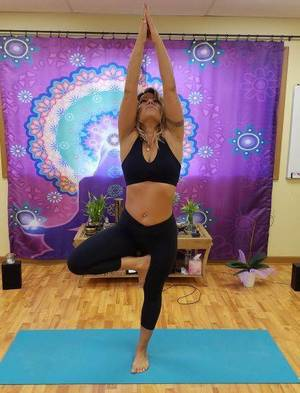 Kerri demonstrating the tree pose during a workshop
