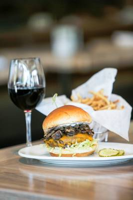 Carousel_image_f462fecd8a4b56704eba_zinburger_-_kobe_burger_with_wine_glass