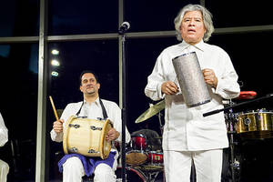 Jaime Figueroa on the tambora with lead singer and band leader José Obando on the merengue guiro at the 'African Roots of Salsa and History of Steel Drums' concert at Horace Mann on Feb. 12.
