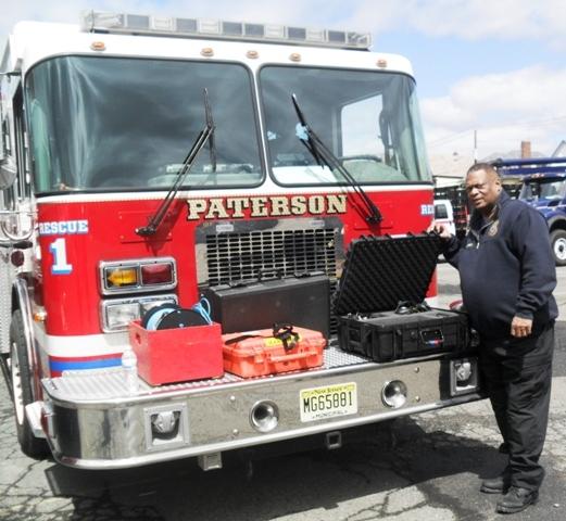 d8591ed40648a791cc95_AP_public_Safety_Director_Glenn_Brown_demonstrates_disaster_equipment.jpg