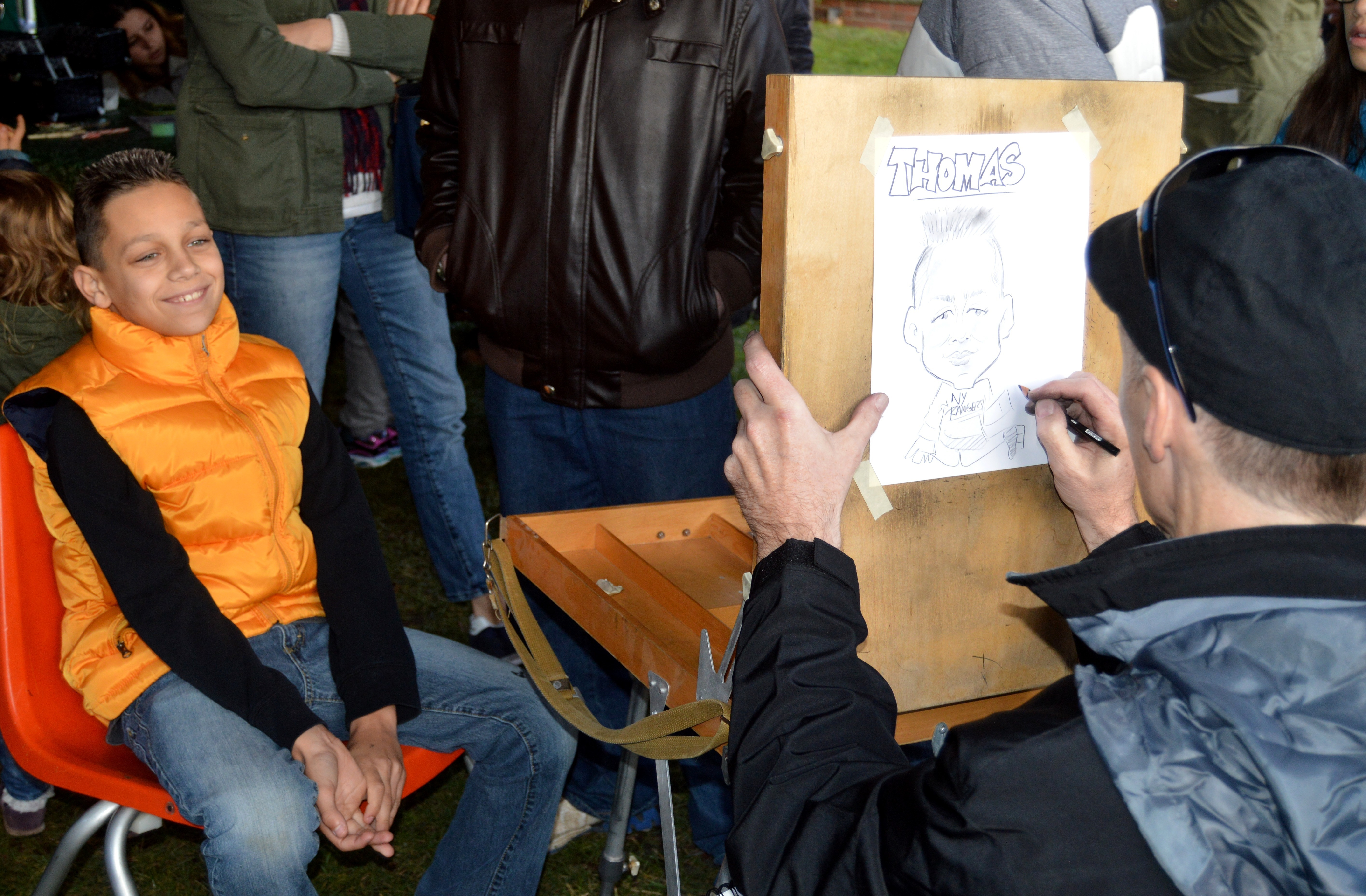f29ffe68ff4e20f4dfd1_Thomas_DeVito_gets_his_portrait_drawn.JPG