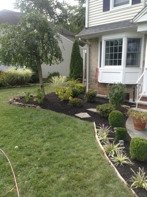 Ince Landscape Construction & Management's new home landscape.