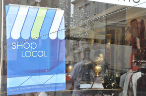 "As sign promoting ""shop local"" at Flowers in the Attic."