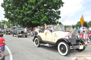 Old-fashioned cars toodled by the spectators.