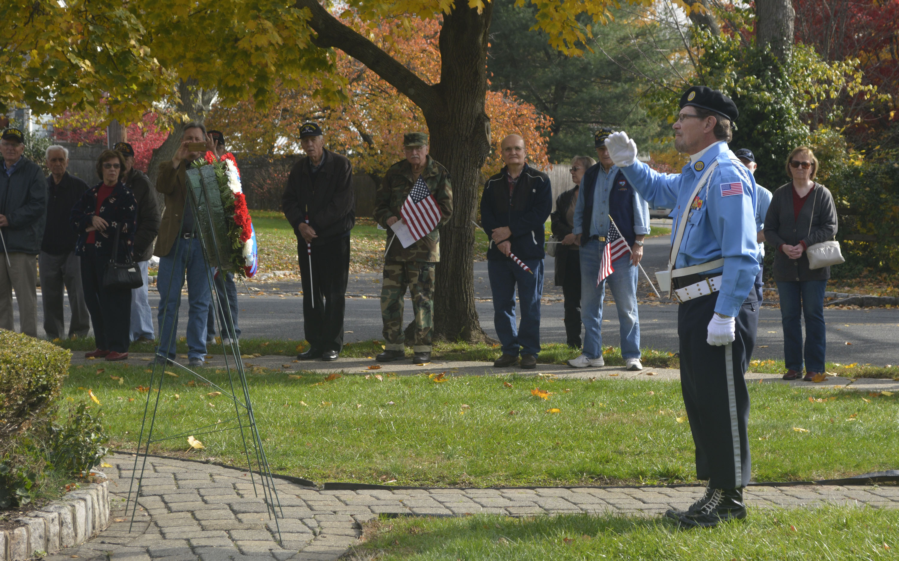b48c118b5ed1d47f3c01_Scotch_Plains-Fanwood_VFW_Post_10122_commander_Earl_Pavlik_of_Scotch_Plains_-_Vietnam_War_army_vet_-_delivers_a_salute_after_placing_a_wreath_at_the_memorial_in_front_of_the_Fanwood_Memorial_Library.jpg