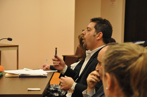 Nick Campanella of Fincredit Inc., shows the town council the card.