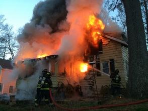 Firemen Fight Fatal Fire on Heighwood Trail