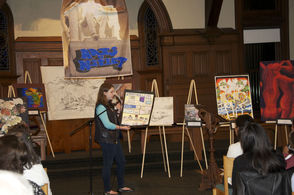 Lyndsay Wittenberg presents her drawing, conveying an anti-cyberbullying message.