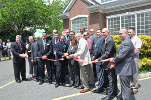 A second ribbon cutting, led by Tammie Horsfield, President of the Sussex County Chamber of Commerce, and employees of CP Engineers & Architecture, as they are surrounded by the company's partners, and dignitaries.