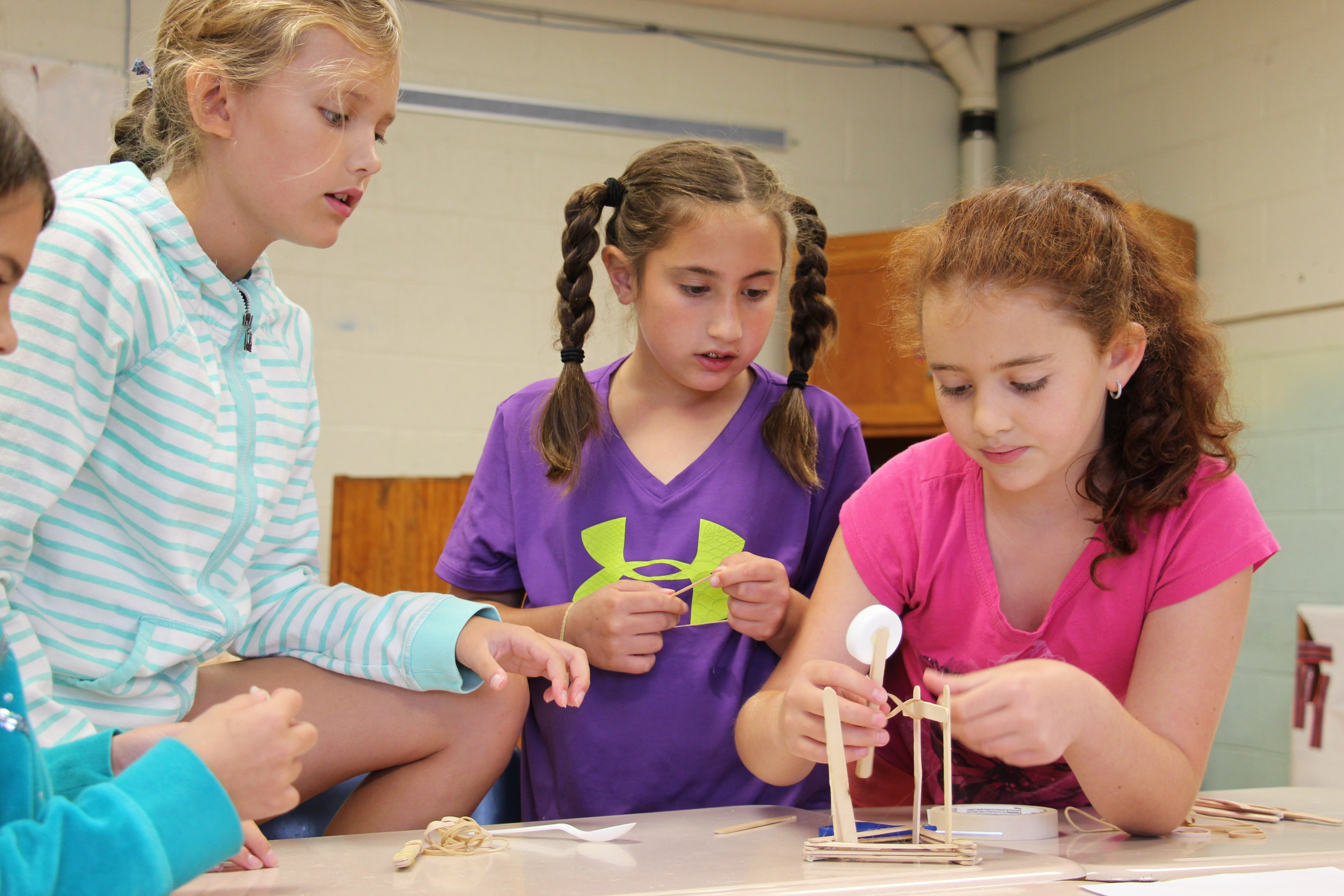 bb4250619df2ed3fad7a_STEM_camp_building_bridge.JPG