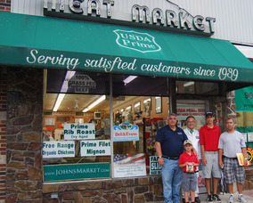 Derek Gutierrez, Mayor Glover, Vincent Losavio and others in front of John's Meat Market in Scotch Plains