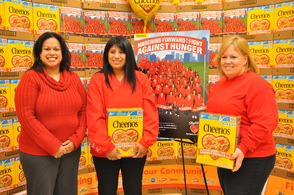 Byram Councilwoman Nisha Kash poses with Denise Lewis and Jennifer Wilson of the Byram Store each hold a Cheerios Box, in which they are featured in a photo on back.