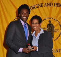 Chukwuemeka S. Nwigwe, School of Health Related Professions, with UMDNJ Interim President Dr. Denise V. Rodgers