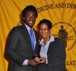 Chukwuemeka S. Nwigwe, School of Health Related Professions, with UMDNJ Interim President Dr. Denise V. Rodgers