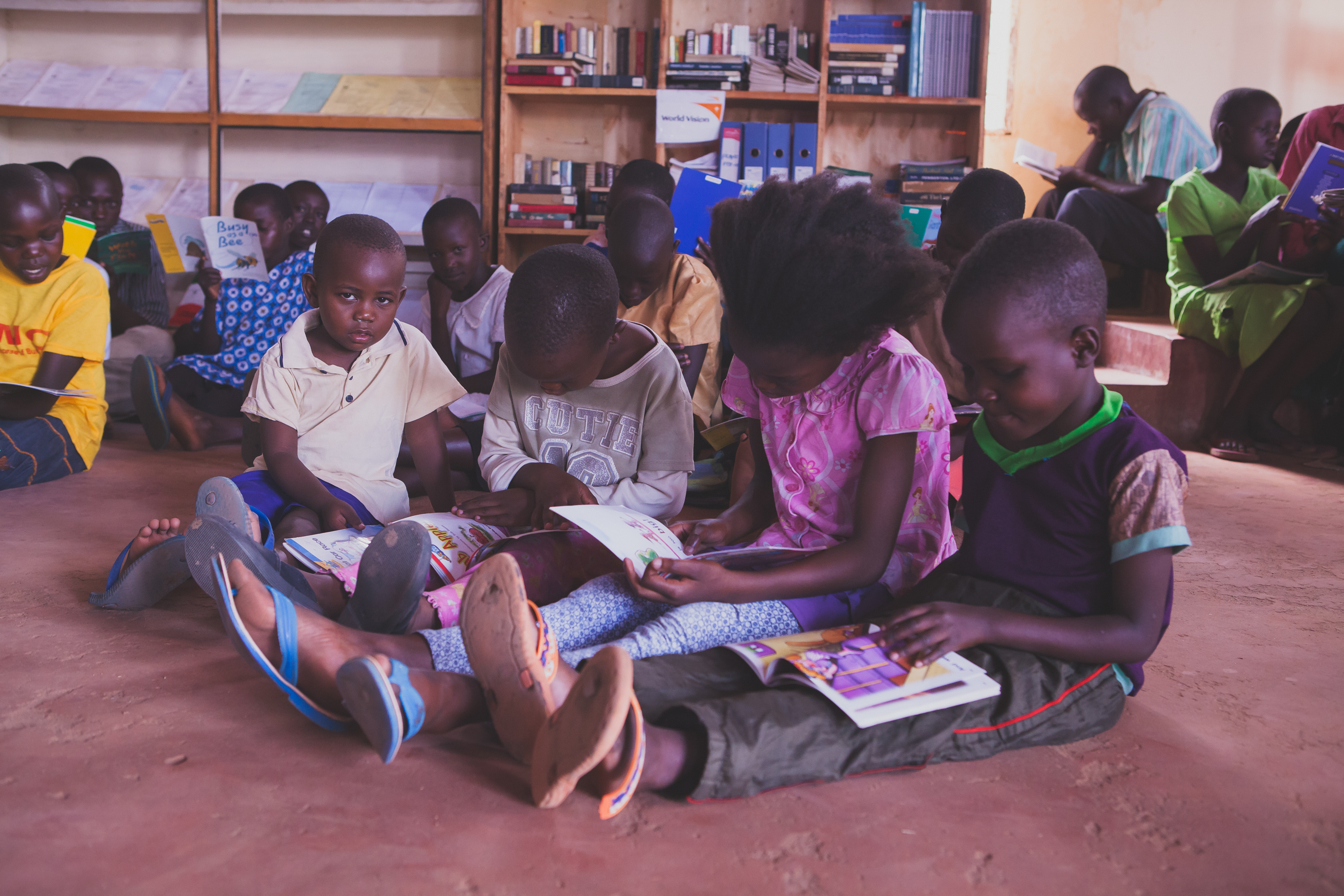 9a3ca8a5871a40fbd302_Children_reading_at_library_NP.jpg
