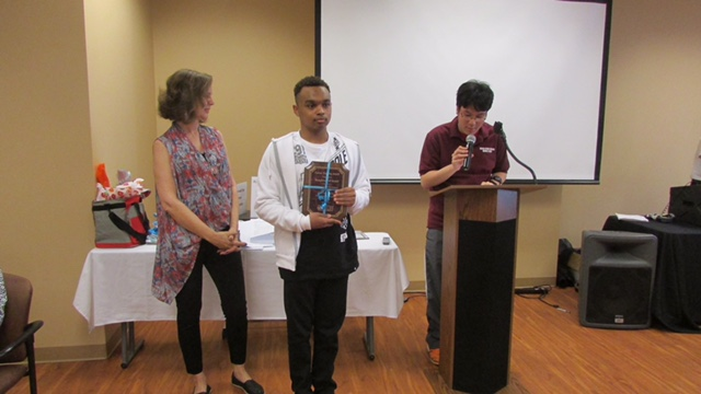 eabdc60717ac76f83200__l-r__Deron_School_students_Henry_Legaspi_and_Jai_fReyce_Somerville_presenting_the_award_to_Eve_Goldberg__far_left_.jpg