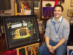 Ricardo Roig sits with a print of his Rialto edition from his Westfield series