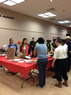 Members of the High School Key club serving Pizza and Salad at the Holiday party