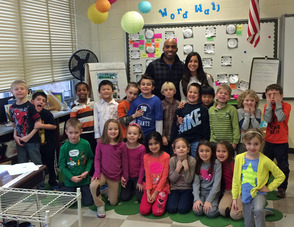 Tiki Barber visits Jenna Mordaga's first-grade class at William Mason Elementary School