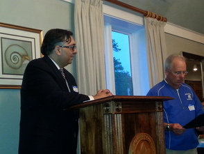 Committeeman Ted Bourke presents Arp Trivedi with a proclamation from the Township.