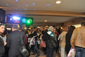 Attendees are drawn into one of the rooms, filled by strobe lights, sun tan spraying booths, food, and more.
