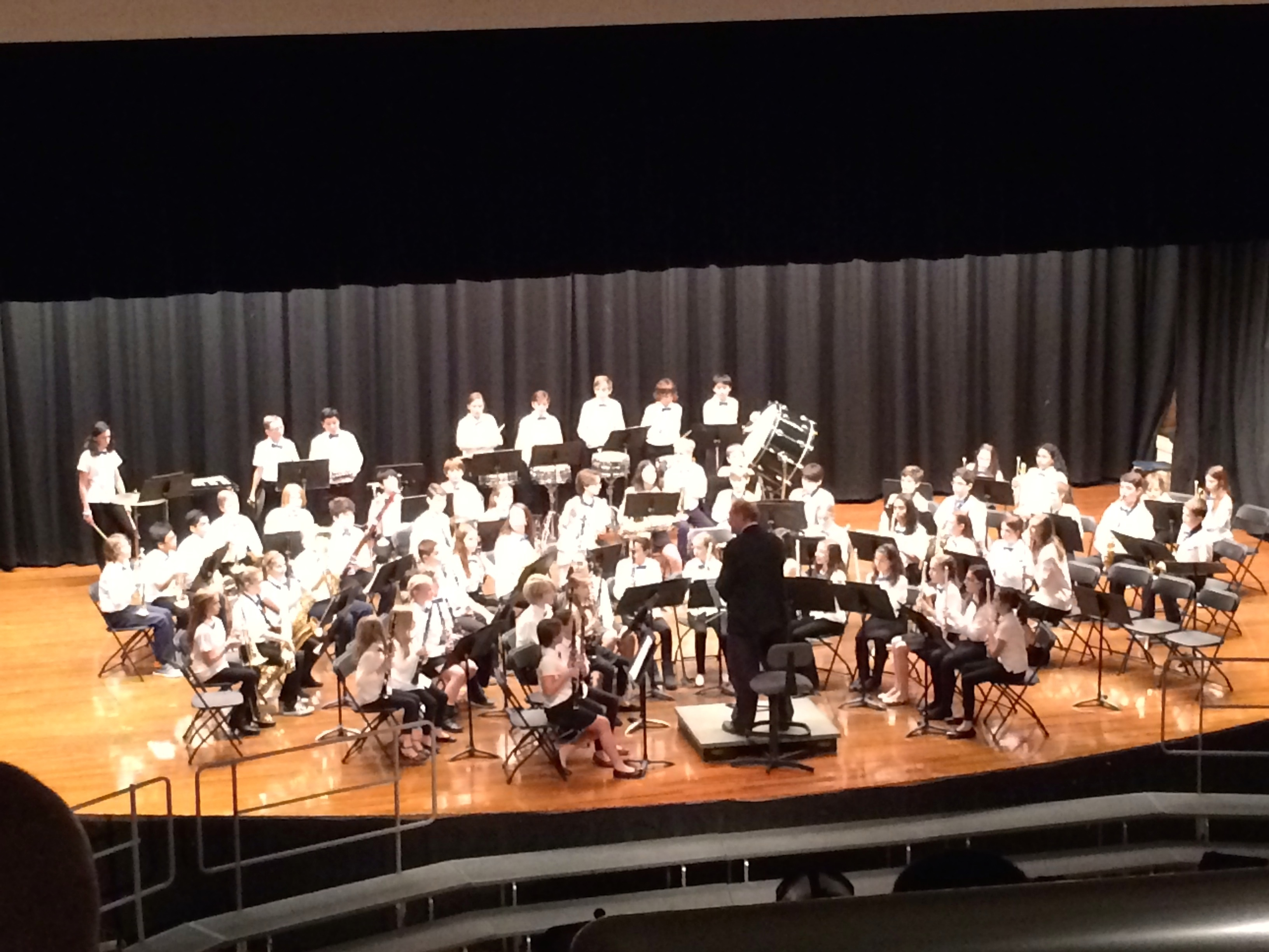 ae37afd1af093dc860c1_3630d5ddb4b3b3c7fef9_Joe_Bassin_leads_the_7th_grade_Band_at_their_concert_December_8th.jpg