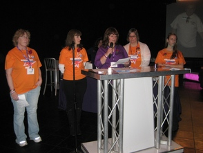 American Cancer Society director of special events Tracey DePano (center) addresses the audience, flanked by Relay for Life committee members (left to right) Cathy Trapasso, Barbara Bartolomeo, Anne Meyer, and Kathy Meyer, at the Relay for Life of Madison/Florham Park kick-off celebration at Powerhouse Studios on Wednesday, February 20th.
