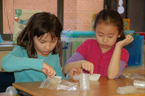 "Salt Brook School second graders Audrey Thompson and Grace Qin make honeycomb during ""Get Buggy,"" an interactive science lesson about insects."