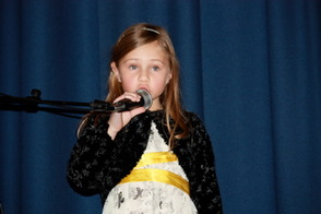 Scarlett Smith-Weiner, 1st grader, sang I Want to Build a Snowman from the movie Frozen