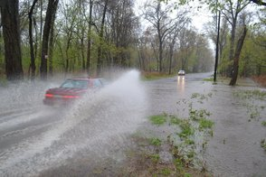 Car Driving Through Standing Water on Jefferson Avenue