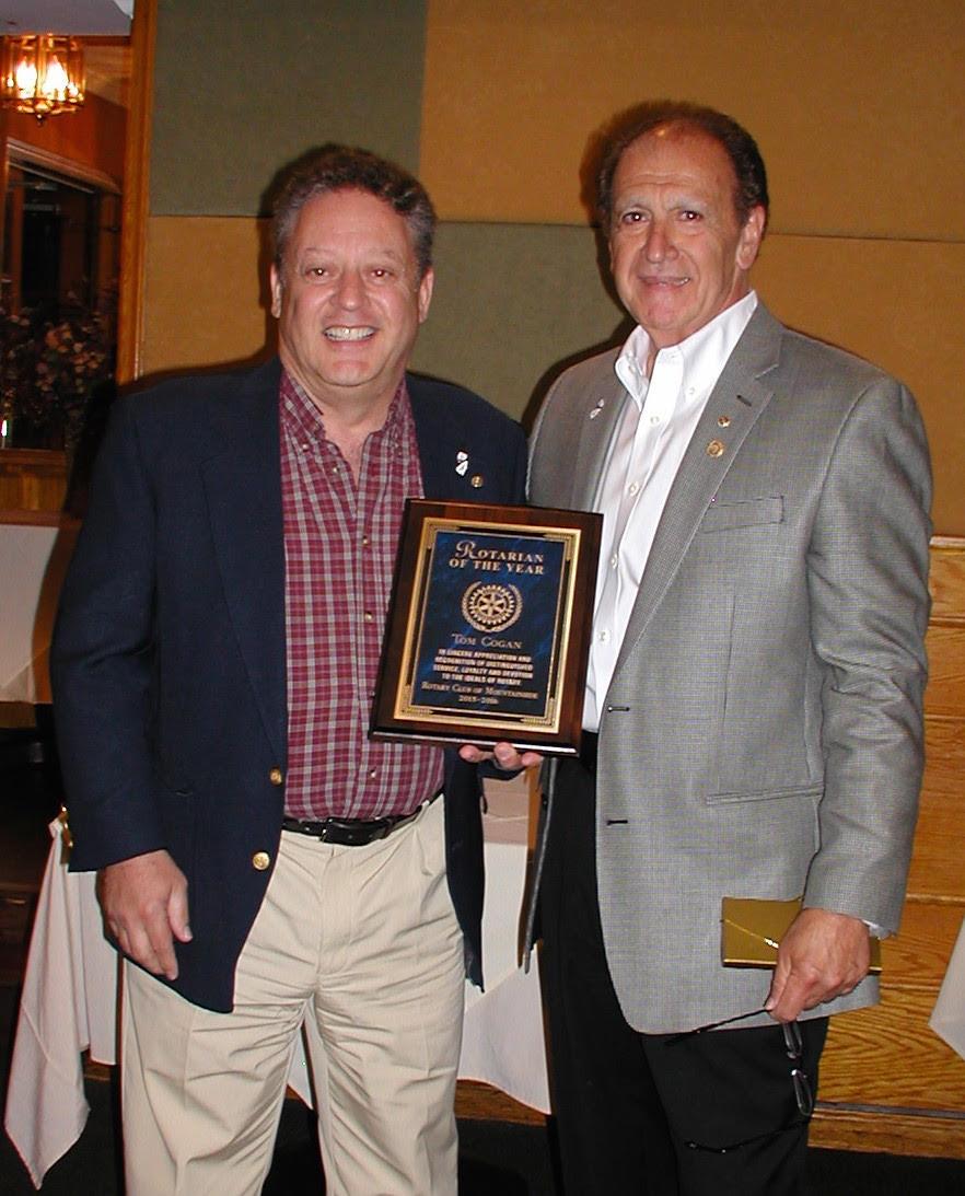 baf838f6ba77735d722c_Tom_Cogan_Receivign_Rotarian_of_the_Year_Award.jpg