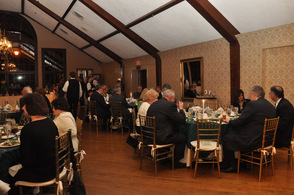 Guests mingle at the dinner on Saturday night.