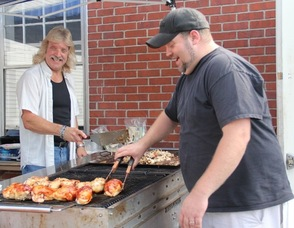 Don and Tim grilling chicken.