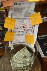 Top_story_e58d72f2bdde6bd982dd_buy_a_vet_a_burger_at_john_s_meat_market
