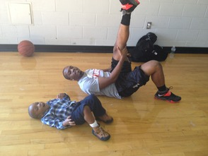 De'Von Randolph and son Nadir, 3, Stretch before Tryouts