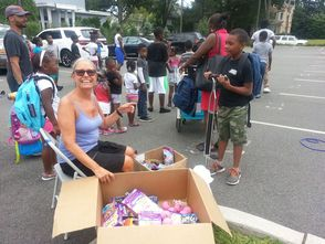"Beverly De'Andre, MEA FAST chairperson, passes out ""goodies"" to the children."