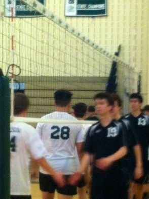 Boys Varsity Volleyball Shaking Hands After the Win